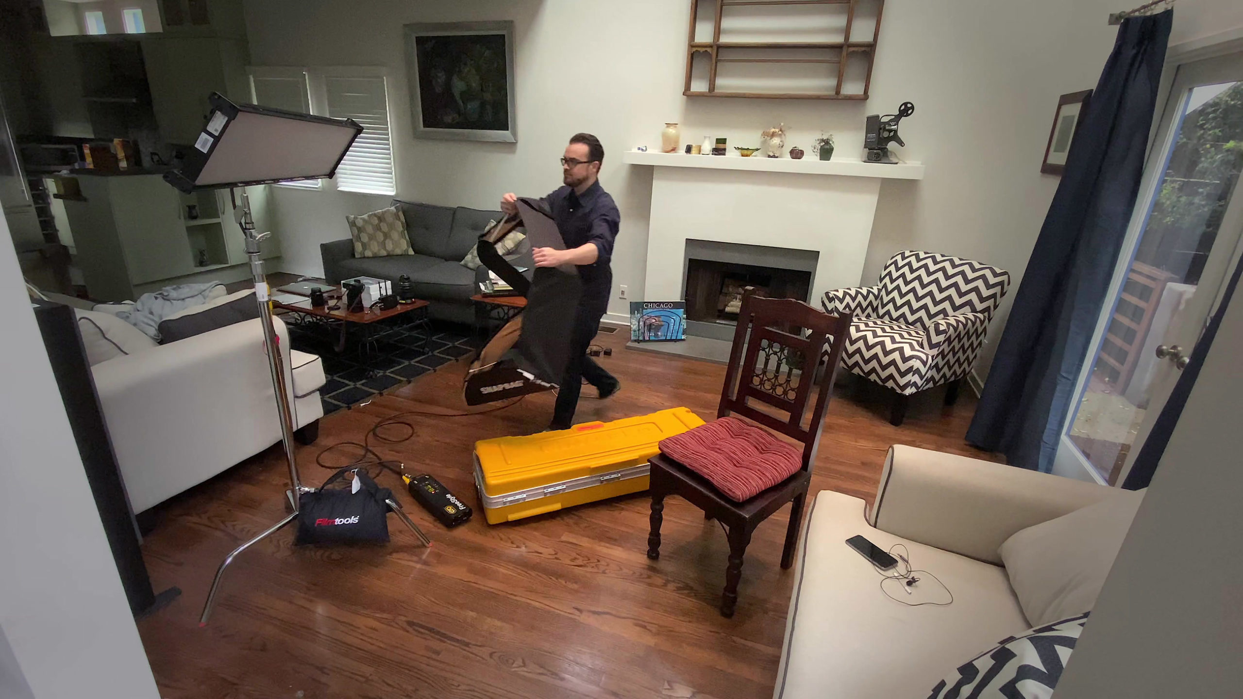 Michael Cioni sets up lights for the Workflow From Home set.