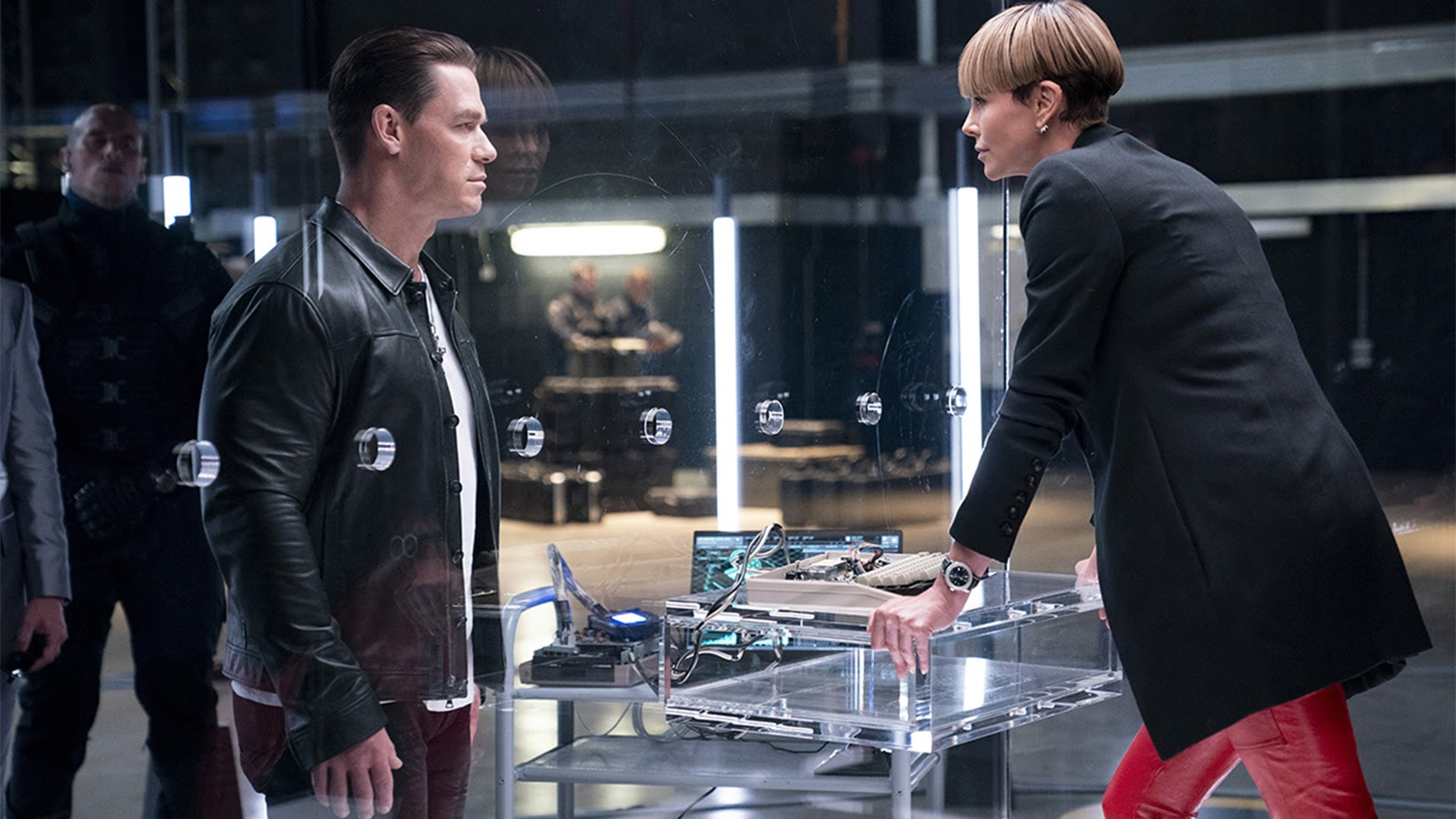 Jakob (John Cena) and Cypher (Charlize Theron) in F9